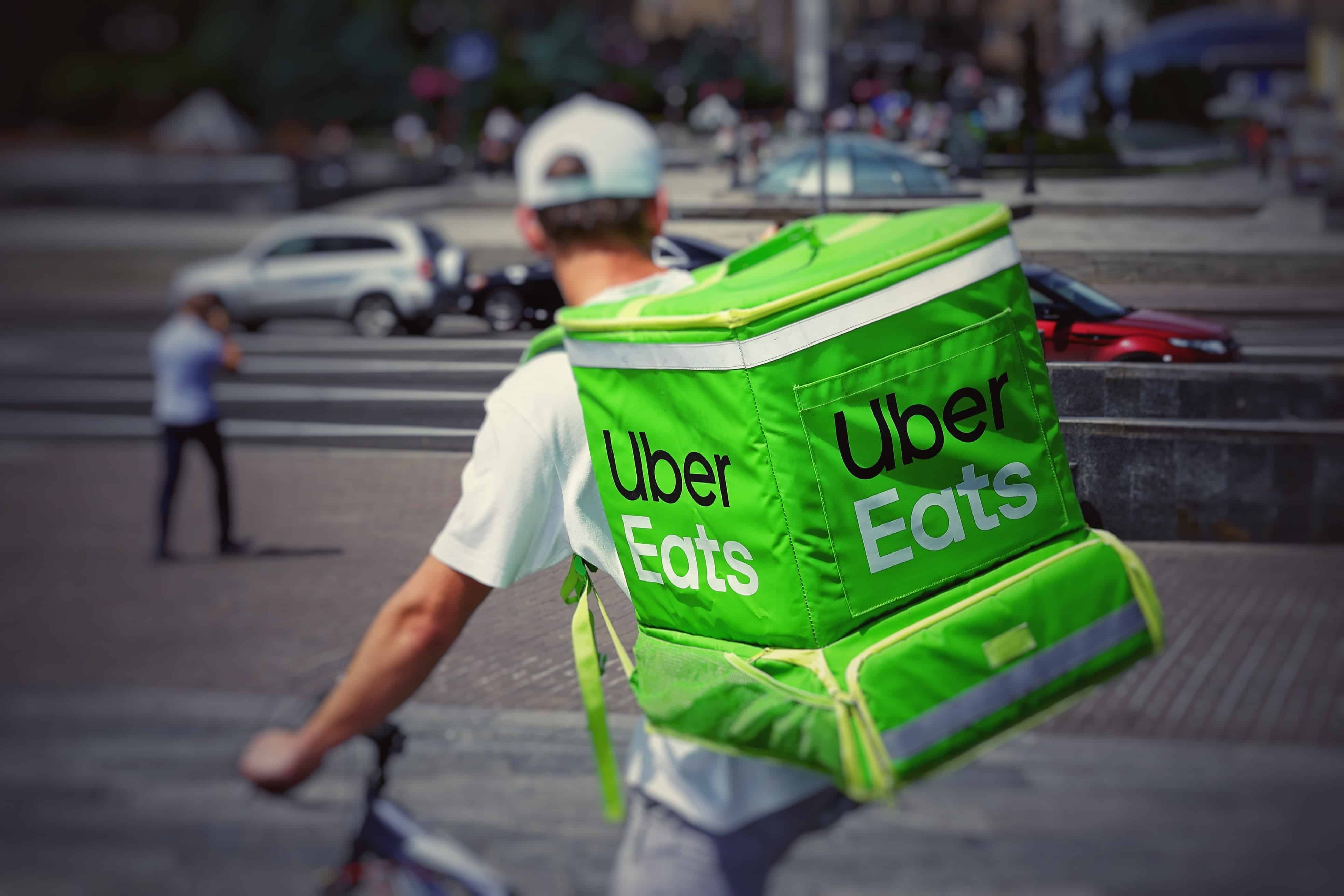 man-wearing-Uber-Eats-backpack-for-food-delivery