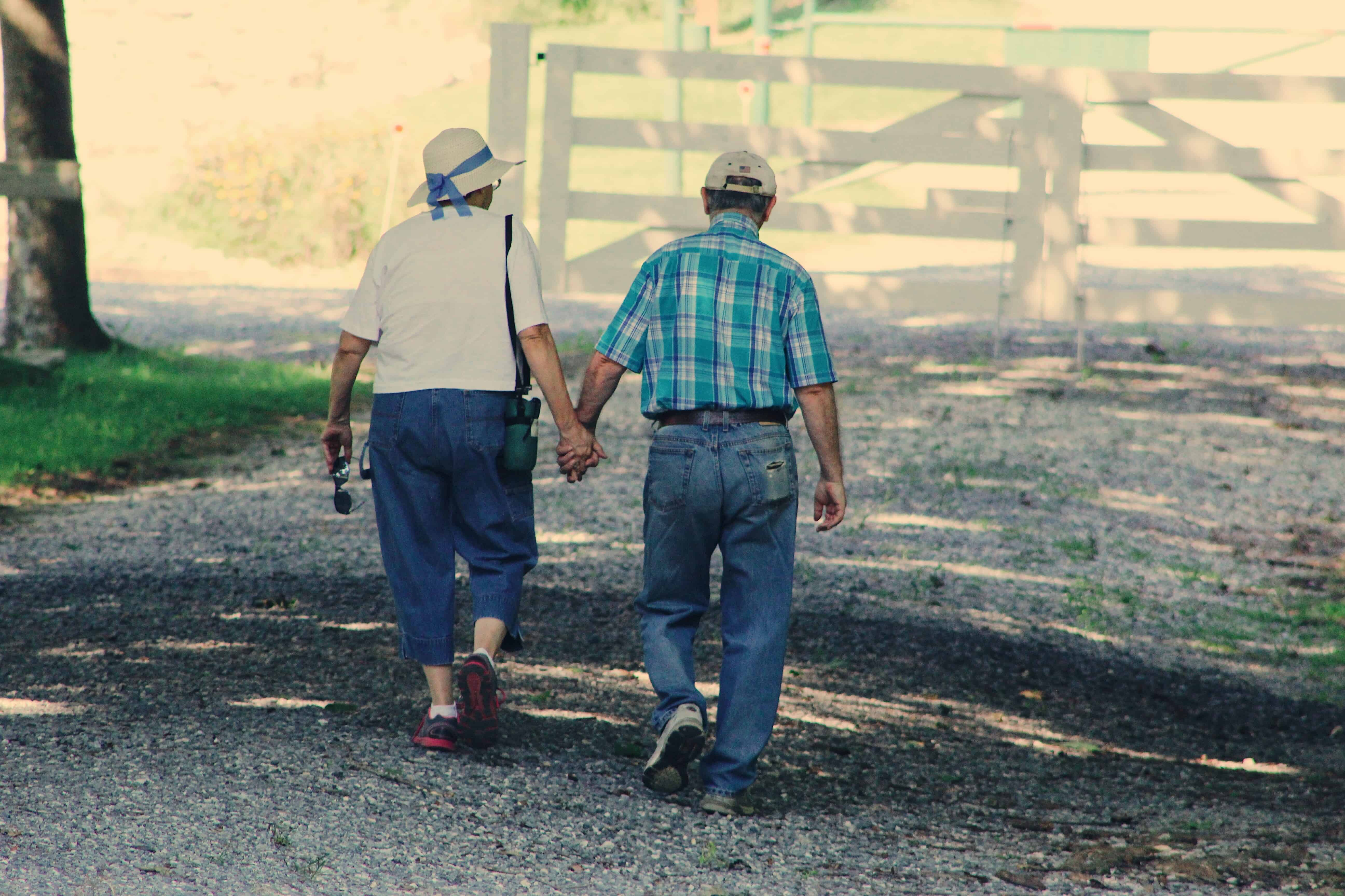 senior-couple-walk-while-holding-hands