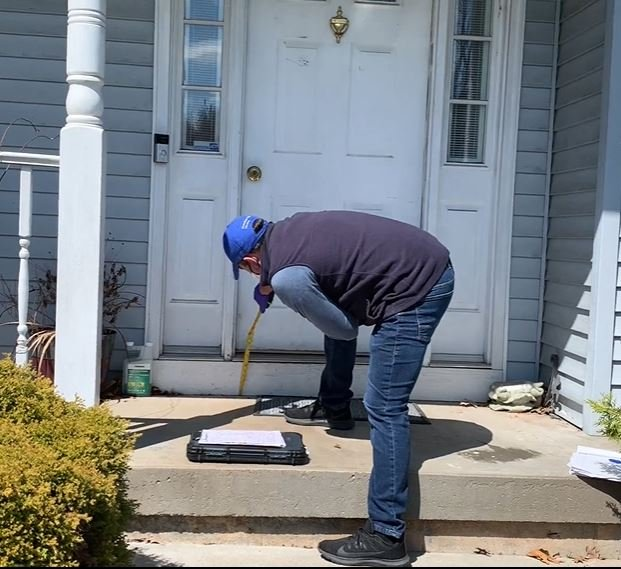 Lifeway Mobility accessibility expert taking measurement of front stoop for install of rental wheelchair ramp