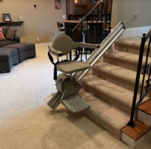 Bruno Elan rental stair lift at bottom landing of staircase in home in Indianapolis