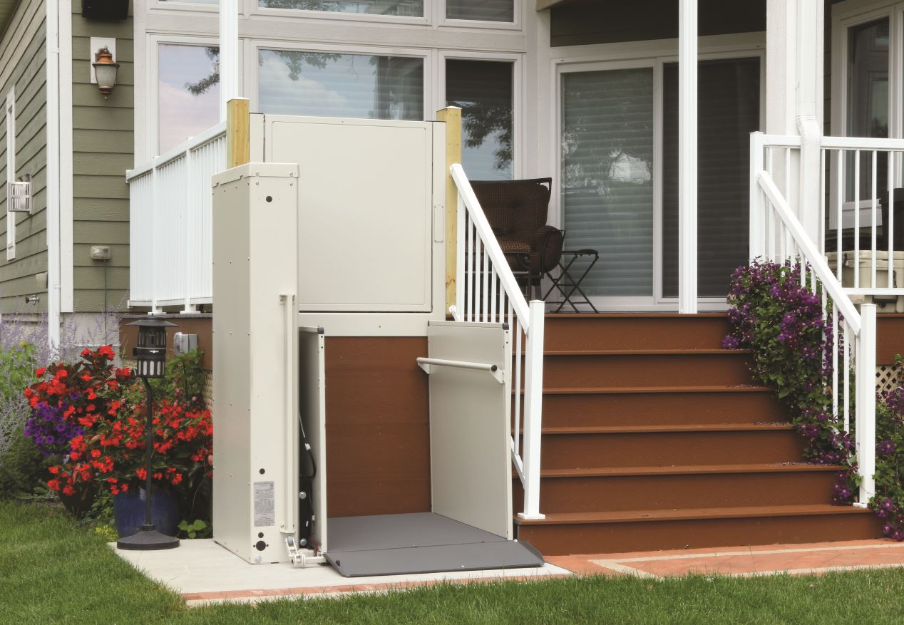 porch lift providing safe wheelchair access to backyard garden