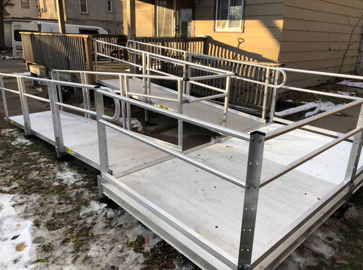 aluminum wheelchair ramp installed with snow on ground in Minnesota