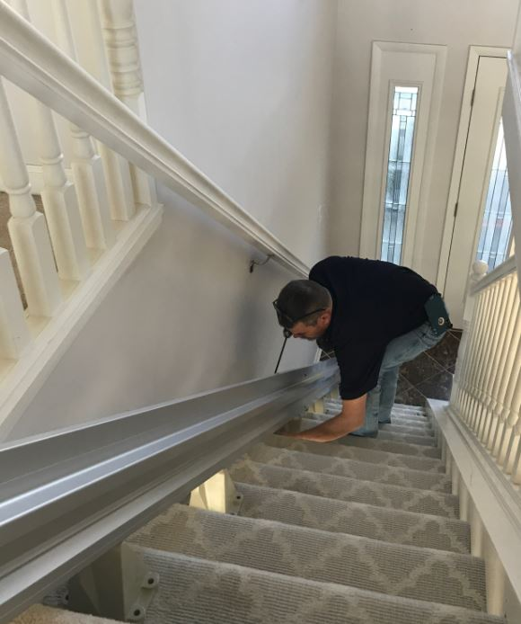 Lifeway Mobility technician installing a stair lift in a home in Indianapolis
