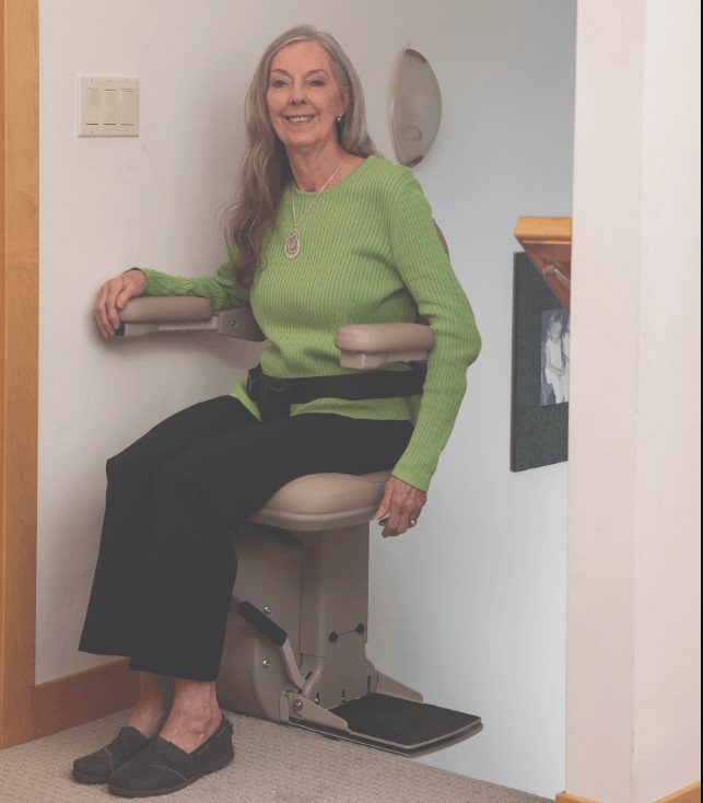 woman utilizing the arm-activated power swivel seat on a Bruno Elite stair lift