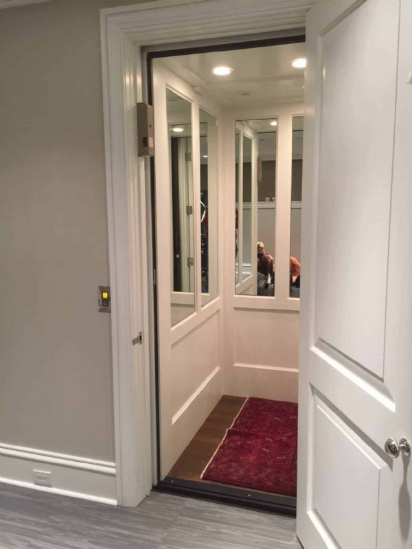 home-elevator-in-Chicago-with-half-wall-mirror-cab-interior.jpg