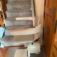 Bruno-Elan-stairlift-at-bottom-landing-of-stairs-in-RI-home.jpeg