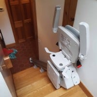 Bruno-Elan-stairlift-components-folded-up-at-top-landing-in-home-in-Weston-Massachusetts.jpg