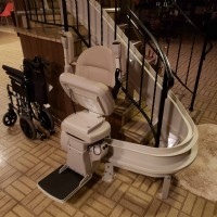 Bruno-Elite-curved-rail-stairlift-folded-at-bottom-of-stairs-in-Wilmette-home.jpg