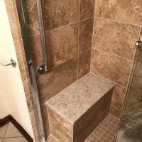 beautiful-shower-with-built-in-bench-and-grab-bars.jpg