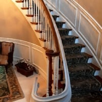 curved-stair-lift-rail-overrun-installed-in-Northbrook-IL.JPG
