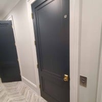 navy-blue-paneled-elvator-swing-door-in-home-on-Chicago-northside.jpg
