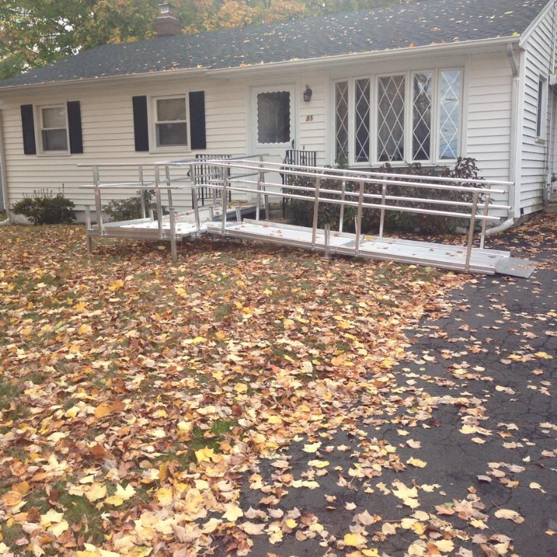 modular wheelchair ramp installation after leaves fell in the autumn season