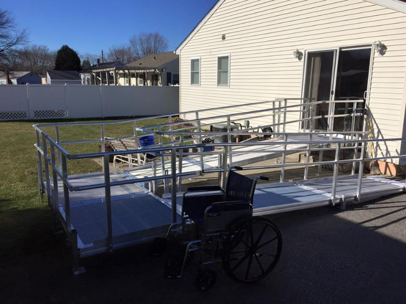 completion of an aluminum wheelchair ramp to provide access to backyard