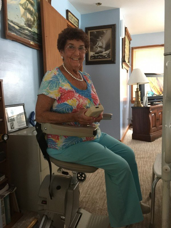 Woman-using-remote-control-to-operate-her-Bruno-Elan-stairlift