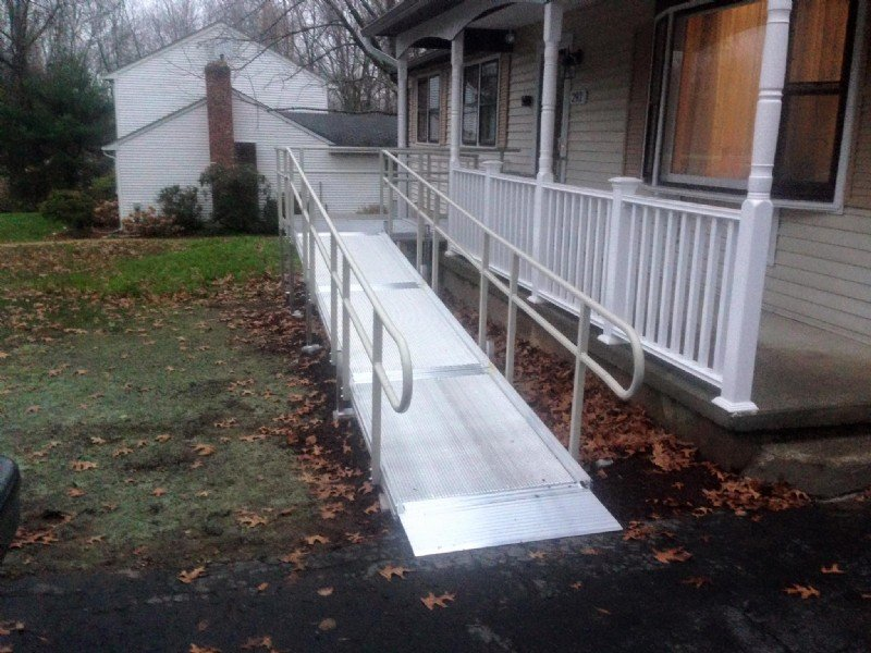 wheelchair ramp leading to front porch of home