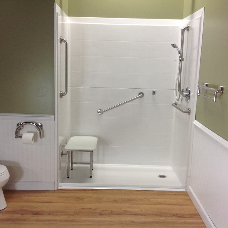 Renovative Bath Systems Barrier-Free Shower with grab bars, an adjustable shower head, and a shower bench
