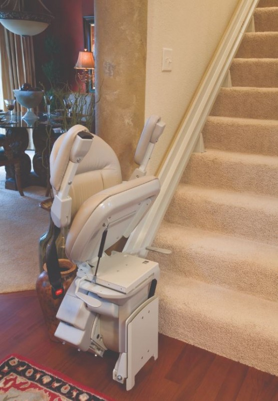 Bruno-Elite-stairlift-with-material-comoponents-folded-up-and-out-of-the-way-of-the-stairs.JPG