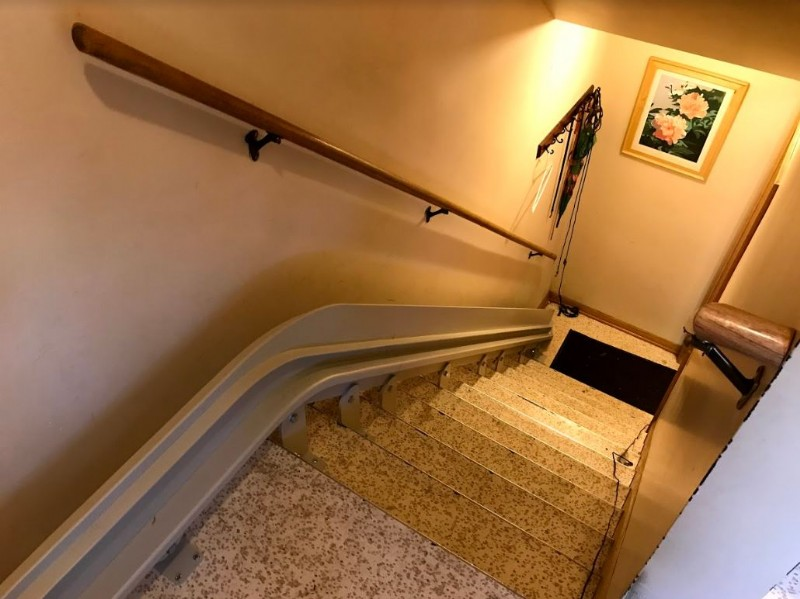 Bruno-curved-rail-mounted-on-staircase-in-home-in-Minnesota.JPG