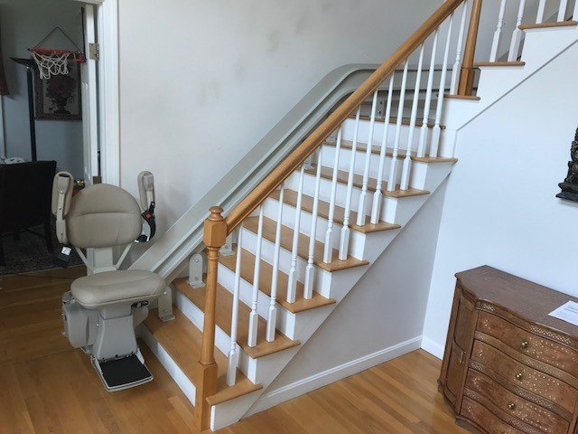 Bruno-curved-stairlift-at-bottom-landing-with-components-folded-up.jpg