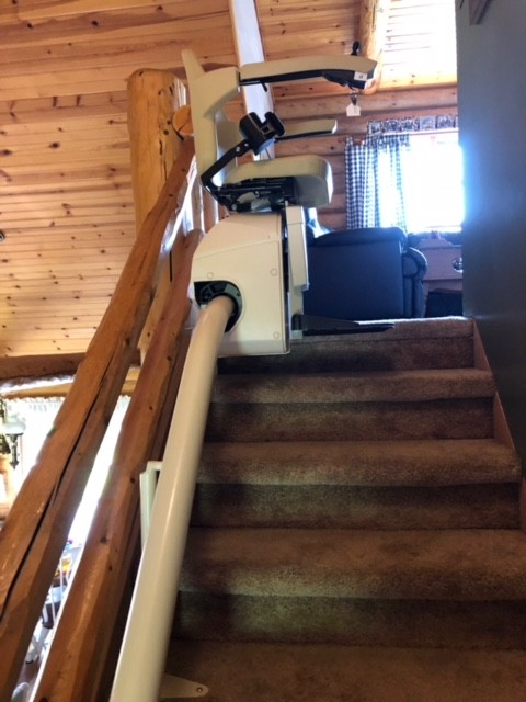 Handicare Freecurve – single rail curved system installed in a cabin