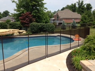 Protect A Child mesh pool fence built around residential pool in Carmel, Indiana