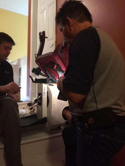 Lifeway-Indianapolis-technician-installing-Handicare-Freecurve-Stairlift.jpg