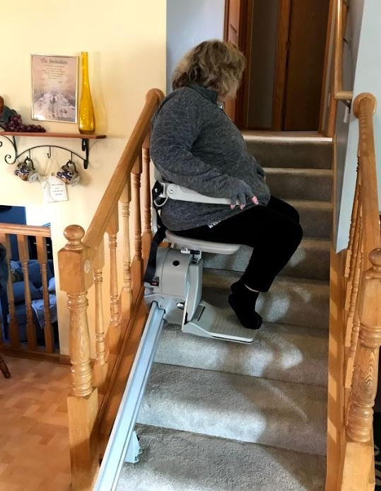 Lifeway-Mobility-Minnesota-customer-riding-her-new-stairlift-for-the-1st-time.JPG