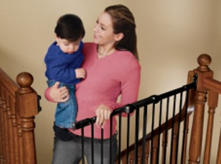Mom Carrying Baby Using a Hardware Mounted Safety Gate