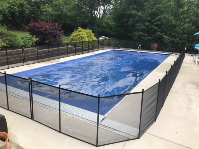 Protect A Child mesh pool fence around clear-covered pool installed by Lifeway Mobility Indianapolis