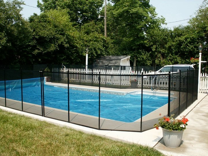 Protect A Child mesh pool fence around clear-covered pool