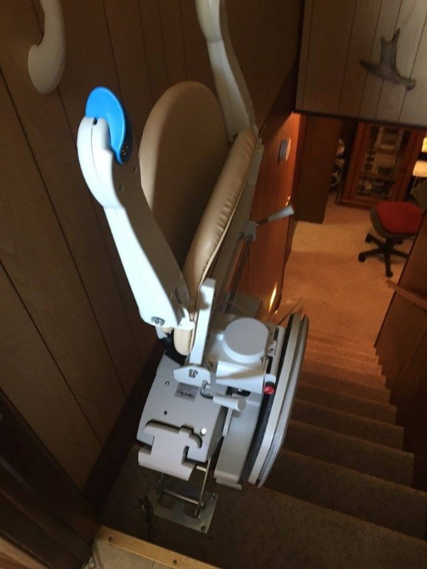 Stairlift-at-Top-of-Basement-Stairs-with-arms-seat-and-footrest-folded-up.jpg