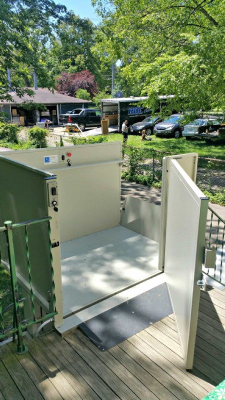 door-of-vertical-platform-lift-open-at-top-entrance-outside-of-home-in-Wilmette-Illinois.jpg