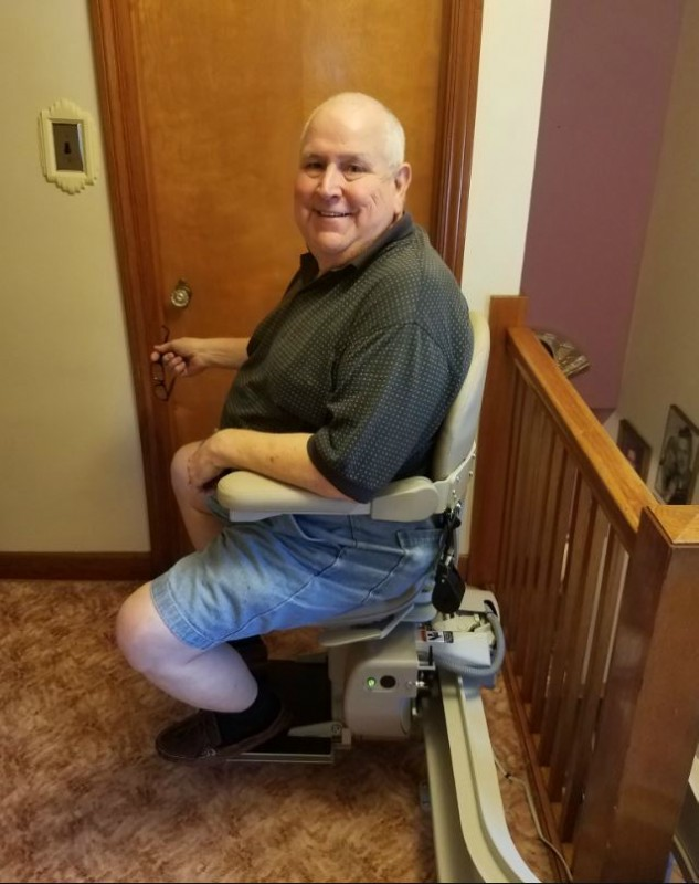 Veteran riding a Bruno Elite curved stair lift installed in Stickney, Illinois