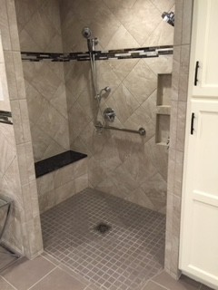 barrier-free-shower-in-Indianapolis-with-bult-in-shower-bench-and-grab-bars.JPG