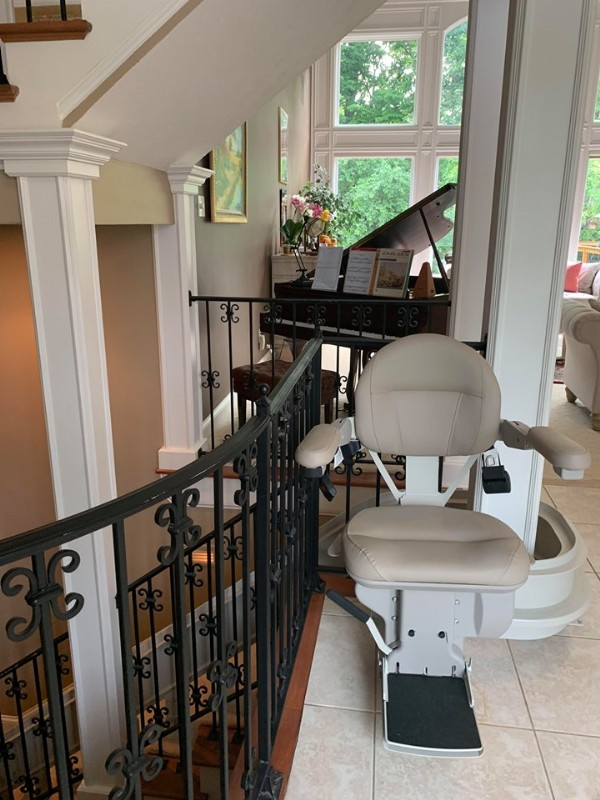 custom-curved-stairlift-with-rail-overrun-at-top-landing.jpg