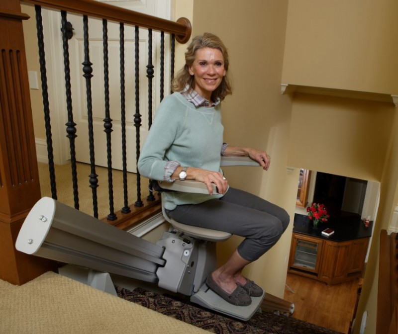 lady-riding-Bruno-Elan-stairlift-near-top-of-steps.JPG