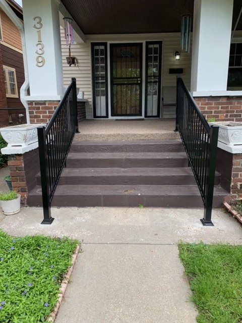 pair-of-handrails-on-outdoor-staircase-for-front-door-access.JPG