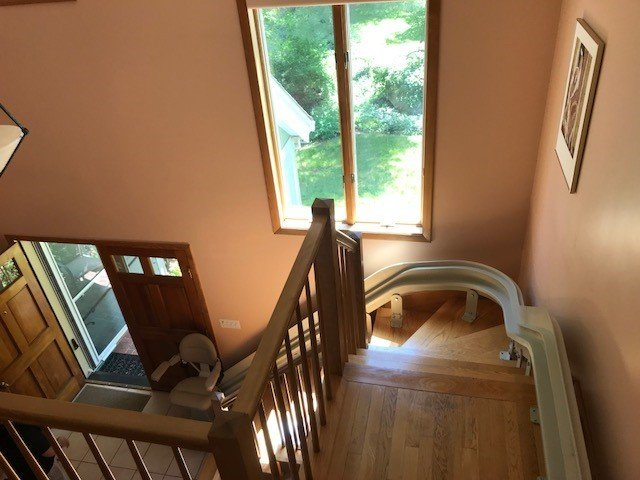 view-of-curved-stairlift-from-top-landing-in-Massachusetts-home.jpg