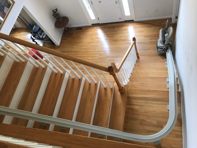view-of-curved-stairlift-from-upper-level-of-Massachuetts-home.jpg