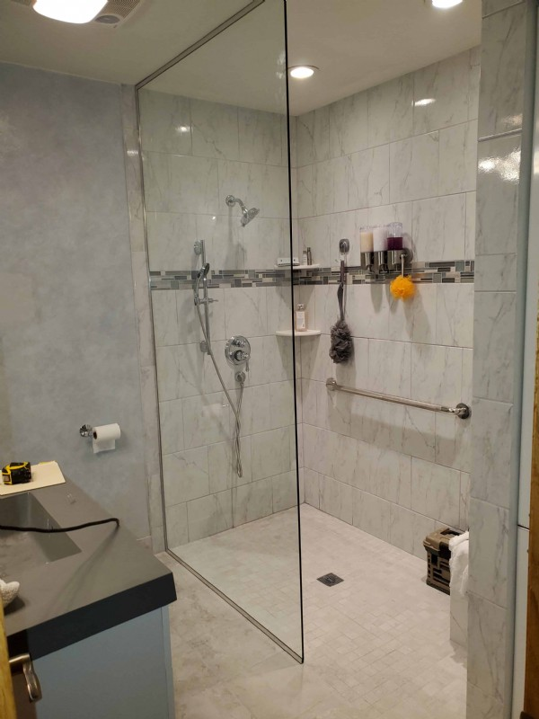 wheelchair-accessible-shower-with-grab-bar-and-glass-shower-door-in-Wheeling-Illinois.jpg