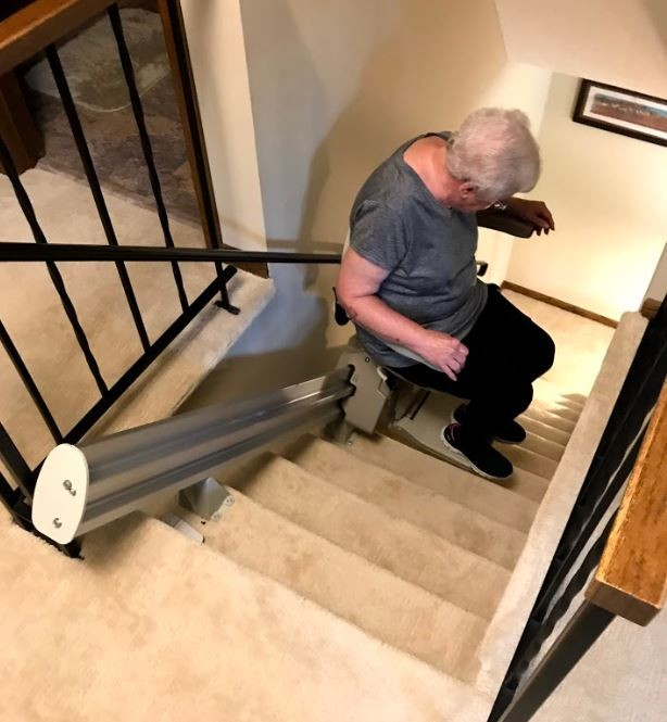 woman-riding-new-stairlift-in-Minnesota.JPG
