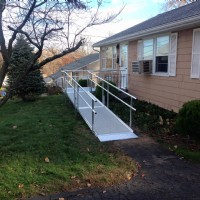 aluminum modular wheelchair ramp to provide access to front door of home