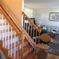 Bruno-Elan-Straight-stair-lift-at-bottom-of-stairs-in-Connecticut-home