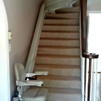 Custom curved Bruno Elite stair lift installed in a local home