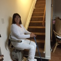 Lifeway-Mobility-customer-riding-Bruno-Elan-stairlift