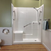 Renovative Bath Systems Barrier-Free Shower with grab bars, an adjustable shower head, molded seat and low threshold