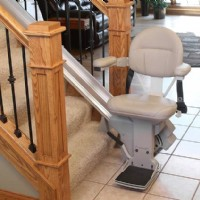 Bruno-Elite-stairlift-at-bottom-landing-of-staircase.jpg