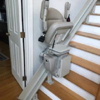 Bruno-curved-rail-stairlift-in-Andover-Massachusetts-with-seat-and-armrests-folded-up.jpg