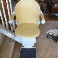 Handicare 1000 Simplicity Series Straight Stair Lift, open at bottom of stairs