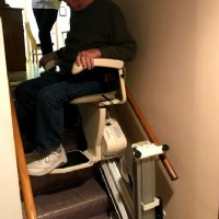 Lifeway-Mobility-Minneapolis-customer-rides-new-Harmar-SL600-stair-lift-equipped-with-power-folding-rail.JPG